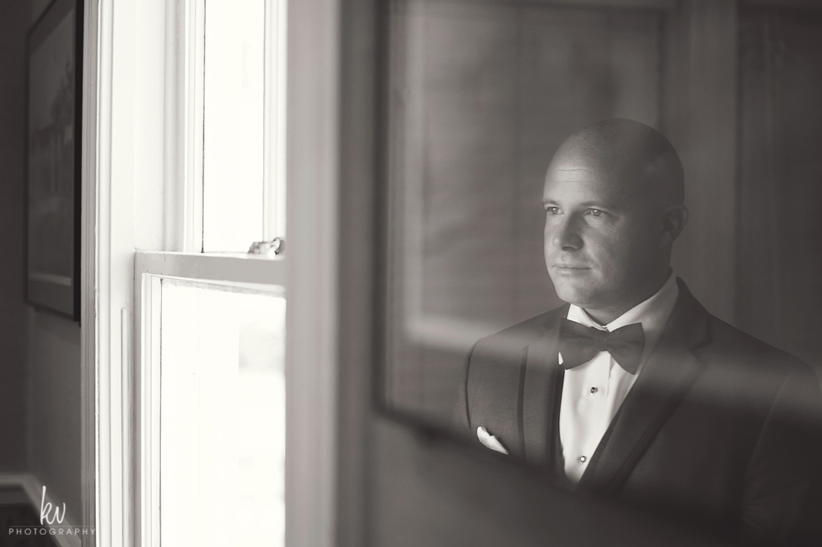 Groom getting ready at Highland Manor on her wedding day